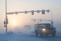 Traffic and ice fog on College road in downtown Fairbanks, Alaska, minus 47 degree temperatures.