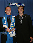 12 January 2007: Michael Harrington (l) was selected by the Kansas City Wizards with the #3 overall pick. Head coach Curt Onalfo (r) poses with him. The 2007 MLS SuperDraft was held in the Indianapolis Convention Center in Indianapolis, Indiana during the National Soccer Coaches Association of America's annual convention.
