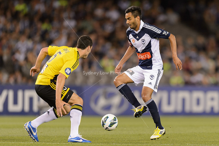 MELBOURNE - 5 NOV: Michael BOXALL of the Phoenix and Marco FLORES of the Victory compete for the ball in the round five A-League match between the Melbourne Victory and Wellington Phoenix at Etihad Stadium on 5 November 2012. (Photo Sydney Low/syd-low.com/Melbourne Victory)
