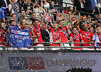 Charlton Club Captain, Chris Solly, who was named as one of the substitutes, holds the Division One Play-Off Trophy aloft as Charlton celebrate during Charlton Athletic vs Sunderland AFC, Sky Bet EFL League 1 Play-Off Final Football at Wembley Stadium on 26th May 2019