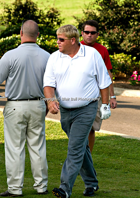 John Daly walking to tee box at TPC Southwind.