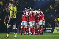 Conor McAleny of Fleetwood Town celebrates with team matesafter he scores the opening goal of the game during the Sky Bet League 1 match between Oxford United and Fleetwood Town at the Kassam Stadium, Oxford, England on 10 April 2018. Photo by David Horn.