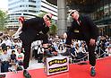 Award-winning pantomimers perform in front of Tokyo Midtown Hibiya