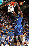 SIOUX FALLS, SD - MARCH 10:  Mario Hines #15 from IPFW slams home two points against Oakland in the second half of their quarterfinal game Sunday night at the 2013 Summit League Basketball Tournament in Sioux Falls, SD.  (Photo by Dave Eggen/Inertia)