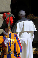 Pope Benedict XVI faces pilgrims gathered in the courtyard of his summer residence of Castelgandolfo, 40 km southeast of Rome, upon his arrival for a weekly general audience on August 31, 2011.