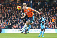 Craig Mackail-Smith of Luton Town in an aerial battle during the Sky Bet League 2 match between Luton Town and Wycombe Wanderers at Kenilworth Road, Luton, England on 26 December 2015. Photo by David Horn.