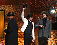 "Xavier de Rosnay, left, and Gaspard Auge, of Justice, accept the award for best dance/electronic album for ""Woman Worldwide"" at the 61st annual Grammy Awards on Sunday, Feb. 10, 2019, in Los Angeles. (Photo by Matt Sayles/Invision/AP)"