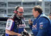 Apr. 1, 2012; Las Vegas, NV, USA: NHRA pro stock driver Larry Morgan (right) with a crew member during the Summitracing.com Nationals at The Strip in Las Vegas. Mandatory Credit: Mark J. Rebilas-