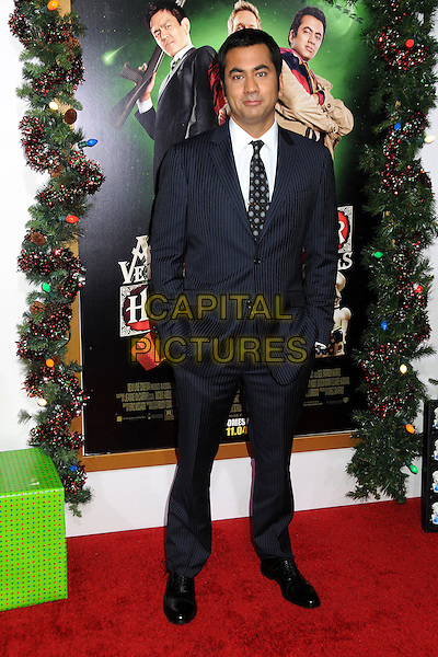 Kal Penn.'A Very Harold & Kumar 3D Christmas' Los Angeles premiere, Grauman's Chinese Theatre, Hollywood, California, USA..2nd November 2011.full length black suit tie blue shirt white .CAP/ADM/BP.©Byron Purvis/AdMedia/Capital Pictures.