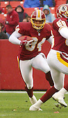 Washington Redskins kick returner Eric Metcalf (34) returns a punt in first quarter action against the Arizona Cardinals in Landover, Maryland on January 6, 2002. The Redskins won the game 20 - 17.<br /> Credit: Ron Sachs / CNP