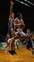 Saints centre Nick Horvath leaps to block as Michael Fitchett looks to pass during the NBL Semifinal basketball match between the Wellington Saints and Nelson Giants at TSB Bank Arena, Wellington, New Zealand on Thursday, 12 June 2008. Photo: Dave Lintott / lintottphoto.co.nz