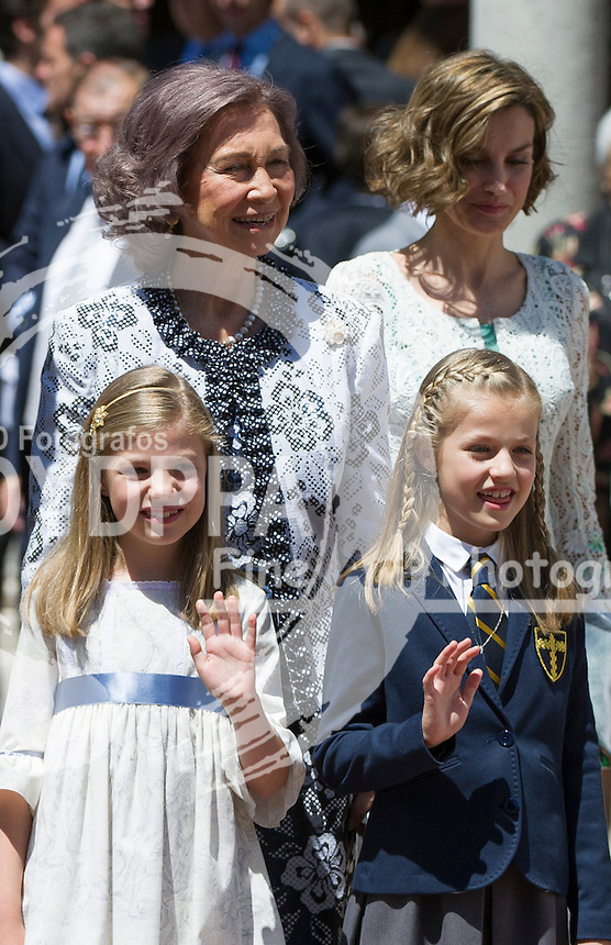 Queen Letizia; King Felipe VI; Former Queen Sofia; former King Juan Carlos I; Princes of Asturias Leonor; Princes Sofia after First communion pose for media out of Church