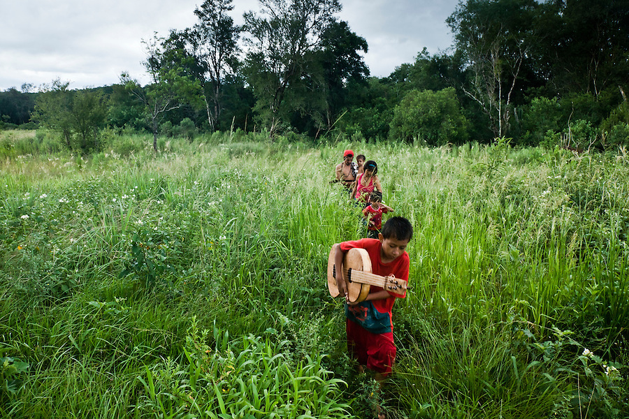 Guarani children from aldea Katupyry near San Ignacio, Misiones, Argentina, with instruments hand-made in the community by a local elder.