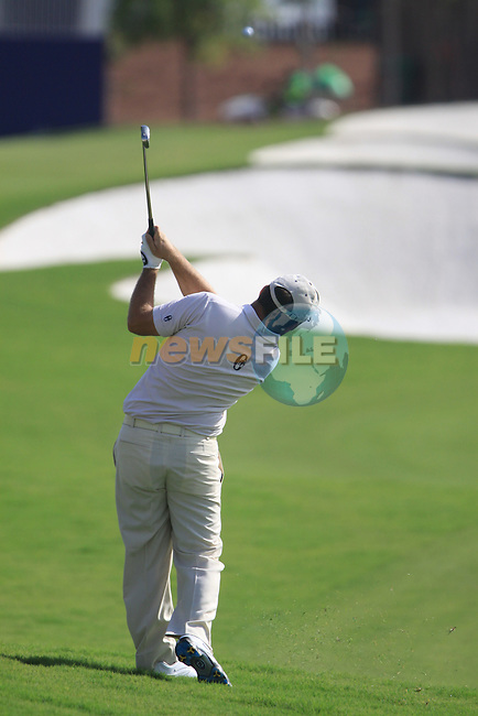 Damien McGrane plays his 2nd shot on the 9th hole during  Day 2 at the Dubai World Championship Golf in Jumeirah, Earth Course, Golf Estates, Dubai  UAE, 20th November 2009 (Photo by Eoin Clarke/GOLFFILE)