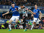 Michael Keane of Everton tackles Ayoze Perez of Newcastle United during the premier league match at Goodison Park Stadium, Liverpool. Picture date 23rd April 2018. Picture credit should read: Simon Bellis/Sportimage