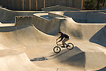 Young male riding a bike at the West Linn Skate Park, Oregon