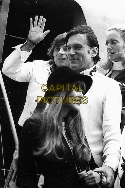 ROMAN POLANSKI & HUGH HEFNER.half length wife girlfriend couple airplane airport hand palm waving white black.CAP/PPG/GRA.©Graziani/People Picture/Capital Pictures