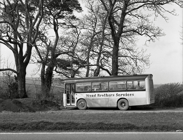 A bus parked by the road from Totnes to Dartmouth