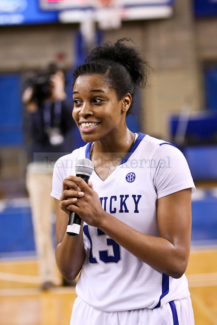 Kentucky senior Bria Goss grabs the microphone to address the crowd after their big win over South Carolina at Memorial Coliseum in Lexington , Ky., on Sunday, March 1, 2015. Photo by Jonathan Krueger   Staff