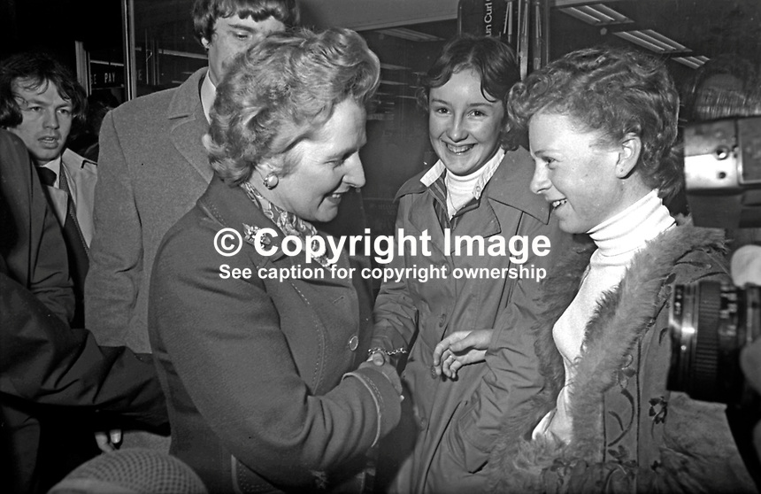 On a walk-about in central Belfast during a brief visit to N Ireland Prime Minister Margaret Thatcher has a word with two young shoppers. February 1977. 197702210048a<br />