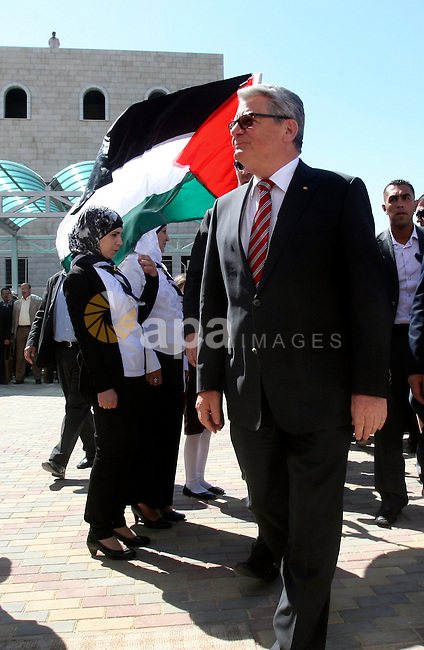 German President Joachim Gauck is greeted by Palestinian girls upon his arrival to the West Bank village of Burin, south of Nablus, to attend the inauguration of a German-funded girls' school on May 31, 2012. Photo by Wagdi Eshtayah