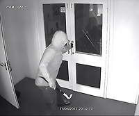 BNPS.co.uk (01202 558833)<br /> Pic: Giggles/BNPS<br /> <br /> One of the alleged burglars trys to force a glass door..<br /> <br /> A businesswoman who watched in horror on her phone as burglars broke into her play centre and smashed up her office says she wishes she had never seen the footage.<br /> <br /> Lisa Dennis, 52, was in the shower when she received a call from her security firm alerting her that the alarm at her business premises had been triggered.<br /> <br /> Mrs Dennis' mobile phone is linked to a CCTV system at the centre, so while she was hurriedly getting dressed she checked the feed and was shocked to see two men ransacking her office. <br /> <br /> Since Mrs Dennis lives only lives five minutes walk from her business she was quickly on the scene but the burglars had already fled with their ill-gotten gains. <br /> <br /> They made off with &pound;2,500 in cash - including &pound;590 set aside for a nursery outing to the local zoo - and caused &pound;10,000 of damage at Giggles Play Centre in Bournemouth, Dorset.<br /> <br /> Mrs Dennis, 52, who has run the business for three and a half years, says she can't sleep at night because every time she closes her eyes she sees the burglars ransacking her business.