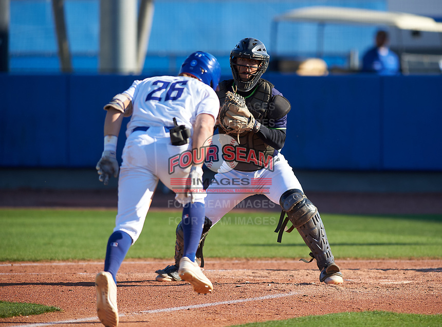 Victory Charter School Knights Lizandro Garcia (21) looks to tag Quinn Blackman (26) out at home during a game against the IMG Academy Ascenders on February 28, 2020 at IMG Academy in Bradenton, Florida.  (Mike Janes/Four Seam Images)