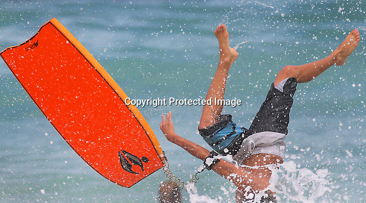 Sandys beach action with high wave on Ohau, Hawaii.