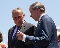 United States Senate Minority Leader Chuck Schumer (Democrat of New York) speaks to United States Senator Tom Udall (Democrat of New Mexico) during a press conference outside of the Supreme Court in Washington D.C., U.S. on July 30, 2019. Credit: Stefani Reynolds / CNP/AdMedia
