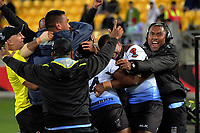 The Fiji bench celebrates at the final whistle of the 2017 Rugby League World Cup quarterfinal match between New Zealand Kiwis and Fiji at Wellington Regional Stadium in Wellington, New Zealand on Saturday, 18 November 2017. Photo: Dave Lintott / lintottphoto.co.nz