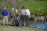 "Rafael Cabrera Bello (ESP) talks with ""Bones"" and a rules official regarding his ball landing in bounds then spinning back down the hill towards the rocks during round 4 of the Arnold Palmer Invitational at Bay Hill Golf Club, Bay Hill, Florida. 3/10/2019.<br /> Picture: Golffile 