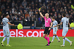 Referee Anthony Taylor shows a yellow card to Hector Herrera of Atletico Madrid for a foul on Cristiano Ronaldo of Juventus during the UEFA Champions League match at Juventus Stadium, Turin. Picture date: 26th November 2019. Picture credit should read: Jonathan Moscrop/Sportimage