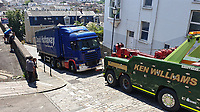 Pictured: A Ken Williams recovery vehicle winches away the David Hathaway articulated lorry which became stuck on Constitution Hill, Wales, UK. Monday 15 July 2019<br /> Re: An articulated lorry that got stuck in Swansea's steepest road, had to be towed away.<br /> The David Hathaway vehicle was attempting to turn from Brooklands Terrace to Constitution Hill just after 11am but successive attempts by the driver proved difficult as the wheels kept losing traction.<br /> Police, a fire service vehicle and a recovery truck attended which helped free the lorry.