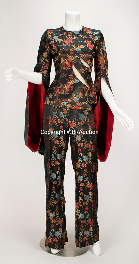 "BNPS.co.uk (01202 558833)<br /> Pic: RRAuction/BNPS<br /> <br /> Pictured: ""The Hunger"" Chinese Silk Slashed Panelled Top Suit: Jacket and Trousers SS 1996 With Pattern has an estimate of $80,000<br /> <br /> A vast archive of items relating to British fashion designer Alexander McQueen have emerged for sale for over £1m.<br /> <br /> The enormous collection has been amassed by one of his personal friends -Ruti Danan who worked worked for the late icon for two years between 1994 and 1996.<br /> <br /> During that period she amassed a treasure trove of items including items of clothing, behind-the-scene photographs and sketches of new designs.<br /> <br /> She has kept the collection for over two decades but has now decided the time is right to part with it for the first time.<br /> <br /> There are an incredible 74 lots set to go under the hammer at RR Auction of Boston, Massachusetts."