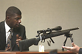 Earl Lee Dancy Jr. of Tacoma, Washington looks over a rifle during his testimony in the penalty phase of the trial of convicted sniper John Allen Muhammad in courtroom 10 at the Virginia Beach Circuit Court in Virginia Beach, Virginia on November 18, 2003.  John Muhammad was convicted of capital murder on November 17, 2003 for his role as organizer of a two-man sniper team that killed 10 people and terrorized the Washington, D.C. area in 2002. <br /> Credit: Dave Ellis - Pool via CNP