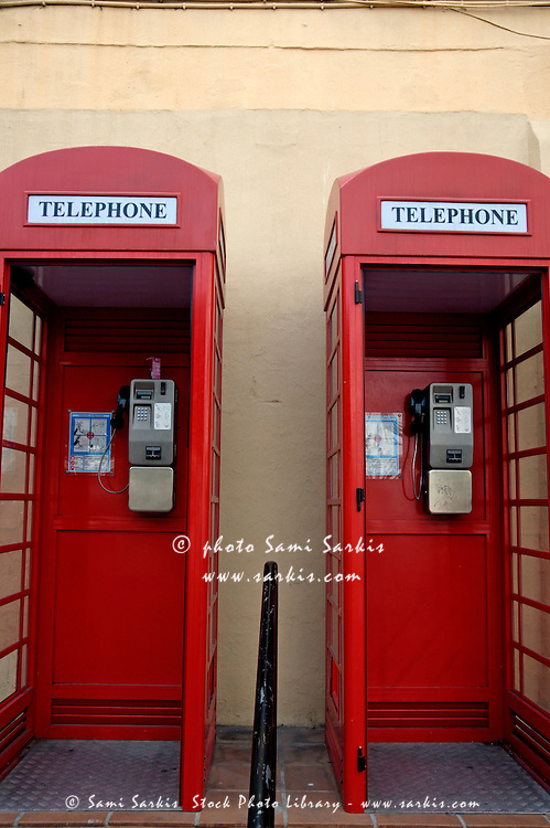 Two old-fashioned public telephone boxes in Gibraltar, British Overseas Territory, England.