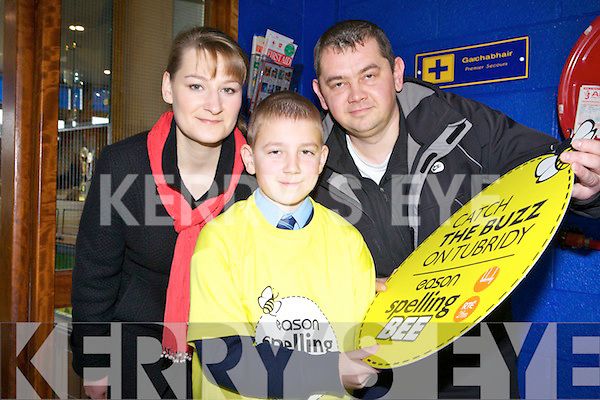 Grigoriy Geniyevskiy from St. Oliver's national school, Killarney who took part in the Spelling Bee at Holy Family school on Tuesday pictured with his mom and dad Anna Geniyevskaya and Yevgeniy Tichshenko.