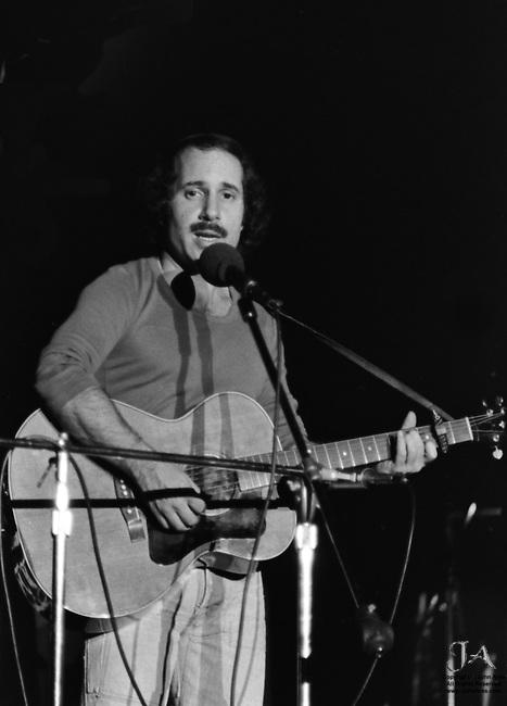 October 24 1975, Paul Simon performing at Seton Hall University and Playing guitar, singing with eyes toward camera