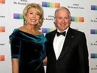 Steven Schwarzman and his wife, Christine, arrive for the formal Artist's Dinner honoring the recipients of the 40th Annual Kennedy Center Honors hosted by United States Secretary of State Rex Tillerson at the US Department of State in Washington, D.C. on Saturday, December 2, 2017. The 2017 honorees are: American dancer and choreographer Carmen de Lavallade; Cuban American singer-songwriter and actress Gloria Estefan; American hip hop artist and entertainment icon LL COOL J; American television writer and producer Norman Lear; and American musician and record producer Lionel Richie. Photo Credit: Ron Sachs/CNP/AdMedia