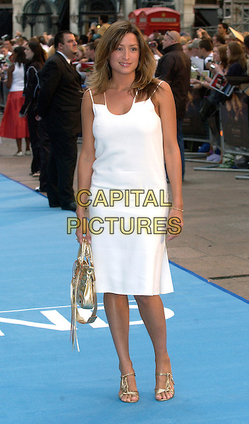 "REBECCA LOOS.UK Film Premiere of ""The Island"" at the Odeon Leicester Square, London..August 7th, 2005.Ref:BEL.half length white dress metallic gold purse bag.www.capitalpictures.com.sales@capitalpictures.com.© Capital Pictures."