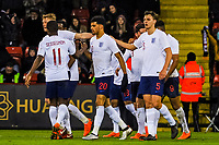 Middlesbrough's defender Dael Fry (5) for England U21's  and ?Nottingham Forest's defender Joe Worrall (6) for England U21's high five in the celebrations during the International Euro U21 Qualification match between England U21 and Ukraine U21 at Bramall Lane, Sheffield, England on 27 March 2018. Photo by Stephen Buckley / PRiME Media Images.