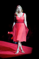 2/13/09 - Photo by John Cheng.  Natasha Henstridge walks down the runway at the Red Dress Collection Fashion Show in Bryant Park, New York.  February is National Heart Month, and the fashion show is part of the month-long activities to raise women?s heart disease awareness.