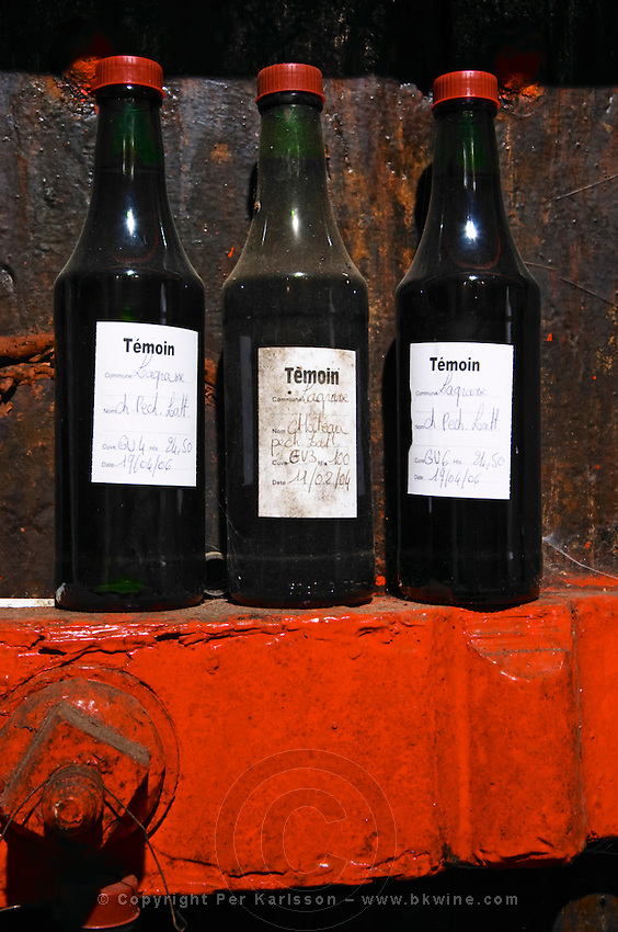 Temoin sample bottles to be used as references. Chateau Pech-Latt. Near Ribaute. Les Corbieres. Languedoc. Samples for control and reference. France. Europe. Bottle.