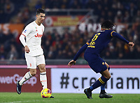 12th January 2020; Stadio Olympico, Rome, Italy; Italian Serie A Football, Roma versus Juventus; Cristiano Ronaldo of Juventus takes on Smalling of Roma - Editorial Use