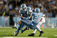 CHAPEL HILL, NC - NOVEMBER 02: Wayne Taulapapa #21 of the University of Virginia is tackled by Chazz Surratt #21 and Myles Wolfolk #11 of the University of North Carolina during a game between University of Virginia and University of North Carolina at Kenan Memorial Stadium on November 02, 2019 in Chapel Hill, North Carolina.