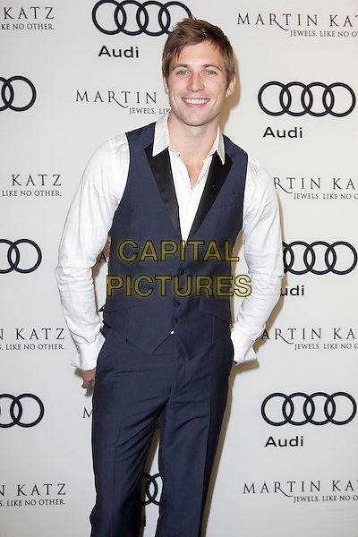 Justin Deeley.Audi And Martin Katz Kick Off Golden Globes Week 2012 Held At Cecconi's Restaurant, West Hollywood, California, USA..January 8th, 2012.half length black trousers waistcoat white shirt hands in pockets .CAP/ADM/ES.©Emiley Schweich/AdMedia/Capital Pictures.