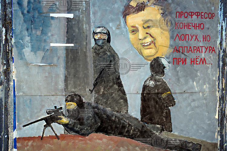 A mural depicting snipers painted on a wall in Kherson.