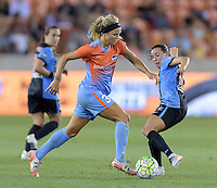 Rachel Daly (3) of the Houston Dash attempts to dribble the ball around Vanessa DiBernardo (10) of the Chicago Red Stars in the second half on Saturday, April 16, 2016 at BBVA Compass Stadium in Houston Texas.