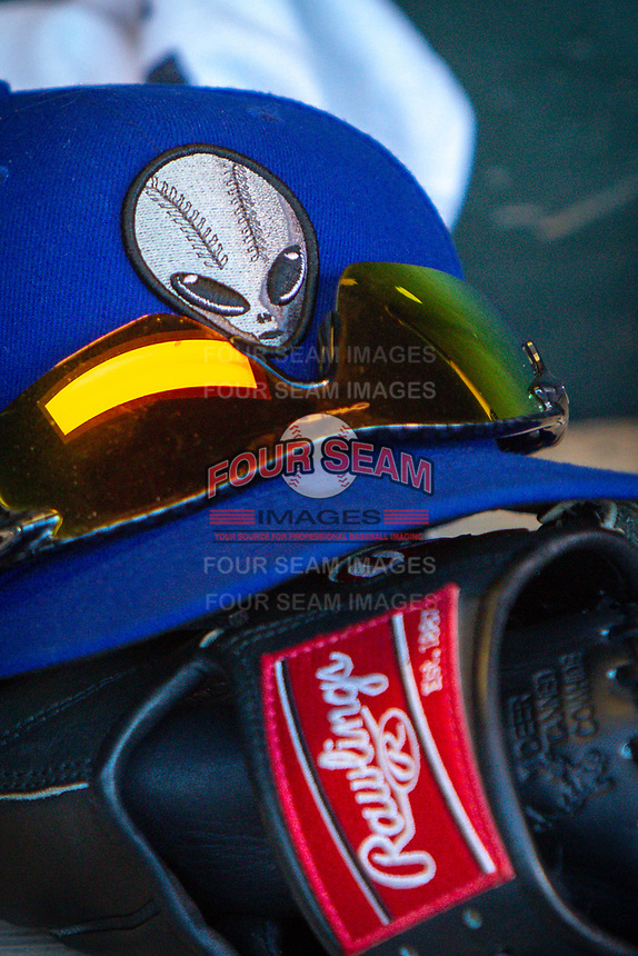 A Las Vegas 51s ball cap and glove in the dugout during a game against the Oklahoma City Dodgers at Chickasaw Bricktown Ballpark on June 17, 2018 in Oklahoma City, Oklahoma. Oklahoma City defeated Las Vegas 5-3  (William Purnell/Four Seam Images)