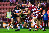 Picture by Alex Whitehead/SWpix.com - 20/04/2018 - Rugby League - Betfred Super League - Wigan Warriors v Castleford Tigers - DW Stadium, Wigan, England - Castleford's Adam Milner is tackled by Wigan's Ben Flower and Joel Tomkins.